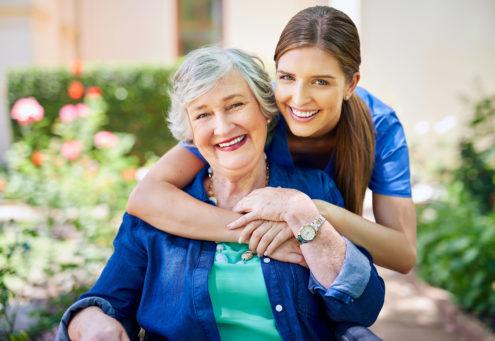 Legacy Pointe Senior Living senior and caregiver smiling